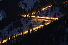 Night Road in winter mountains Royalty Free Stock Photo