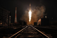 Night rocket. Night launch of the rocket Souz 2.1� from the cosmodrome Baikonur. The flying rocket against the dark night sky. The illuminated railway Royalty Free Stock Photos