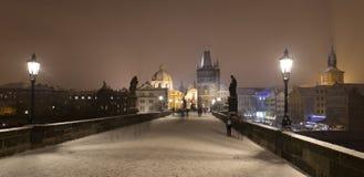 Night romantic snowy foggy Prague Old Town from Charles Bridge, Czech republic Stock Image