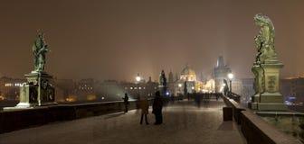 Night romantic snowy foggy Prague Old Town from Charles Bridge, Czech republic Stock Photos