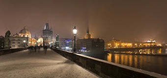 Night romantic snowy foggy Prague Old Town from Charles Bridge, Czech republic Stock Images