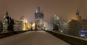 Night romantic snowy foggy Prague Old Town from Charles Bridge, Czech republic Royalty Free Stock Photo