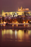 Night romantic snowy Prague gothic Castle and St. Nicholas' Cathedral, Czech republic Royalty Free Stock Photos