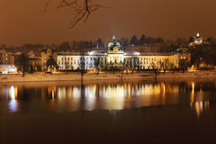 Night romantic snowy Prague Government Office. Czech republic Stock Photos