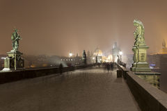 Night romantic snowy Prague Old Town from Charles Bridge with its baroque Sculptures, Czech republic Royalty Free Stock Photography