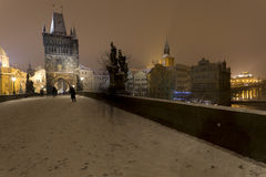 Night romantic snowy Prague Old Town from Charles Bridge with its baroque Sculptures, Czech republic Royalty Free Stock Photos