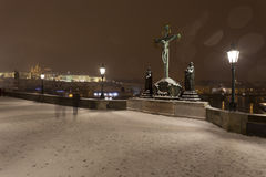 Night romantic snowy Prague Old Town from Charles Bridge with its baroque Sculptures, Czech republic Stock Images