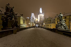 Night romantic snowy Prague Old Town from Charles Bridge with its baroque Sculptures, Czech republic Stock Image