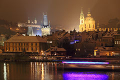 Night romantic snowy Prague St. Nicholas' Cathedral Royalty Free Stock Image
