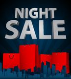 Night sale with shopping bag in city Royalty Free Stock Photos