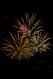Night salute. Fireworks in the evening sky devoted to holiday royalty free stock photography
