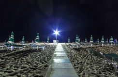 Night sand beach view with umbrellas, Adriatic riviera Stock Images