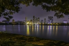 Night scape. Long exposure shot of cityscape with reflection in whater Royalty Free Stock Photo