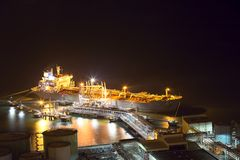 Night scene aerial view of big oil tanker ship loading at oil de Stock Photography