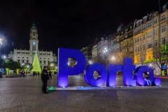 Night scene of the Avenida dos Aliados, in Porto. PORTO, PORTUGAL - DECEMBER 24, 2017: Night scene of the Avenida dos Aliados, and the city hall, with a Stock Photos