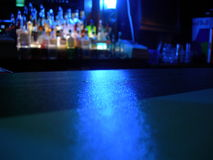 Night Scene Bar. Close up of Bar from inside with glowing look.  Great for beer or shots background.  Place your alcohol on bar and get a great new look Stock Images