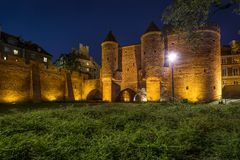 Night scene of the Barbakan in Warsaw, Poland Stock Images