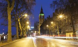 Night scene of Big Ben and London city street with car trails of light. United Kingdom Stock Photo