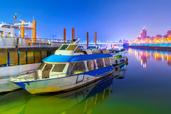 Night scene of boats on a river Stock Image