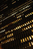 Night Scene of a Building. A night time view of the outside of a high rise building, with some of the interior lights on Stock Photography