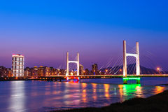 Night scene of cable-stayed bridge over the river Royalty Free Stock Photos