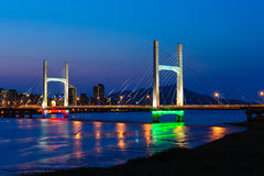 Night scene of cable-stayed bridge over the river Royalty Free Stock Photo