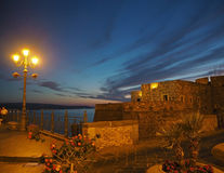 Night scene in city Pizzo, Calbria, Italy - fortress sea view in. Golden lamp light Stock Image