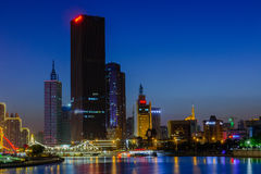 NIght scene cityscape of  Tianjin city at Hai he river zone with. Tianjin,China - September  28,2016 : NIght scene cityscape of  Tianjin city at Hai he river Royalty Free Stock Images