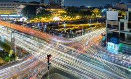 The night scene at the crossroads of bustling. Ho Chi Minh City, Vietnam - May 28, 2018: The night scene at the crossroads of bustling bus crossing creates stock photos