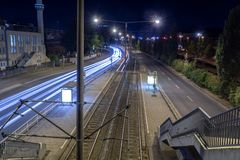 Night scene of a deserted tram station with light trails royalty free stock photo