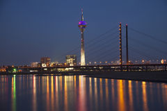 Night scene of Dusseldorf with Rheinturm tower. And Rheinkniebrucke Bridge Royalty Free Stock Photography