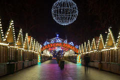 Night scene - empty Christmas marketplace with decorated small kiosk Royalty Free Stock Photos