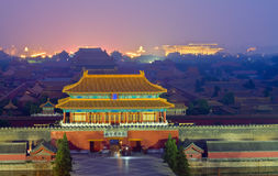 Night scene of the Forbidden City in the fog Stock Photo