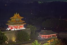 Night scene of the Forbidden City in the fog Stock Photos