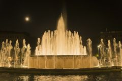 Night lights Sforza Castel fountain. Night scene of the fountain in Sforza Castel square stock photography