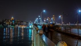 Night Scene Galata Bridge. Urban night scene at the Galata bridge with people walking on it and fisherman fishing stock video