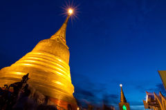 Night scene of golden chedi Stock Photo