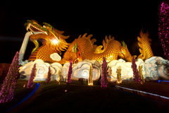 Night scene of golden Dragon in Chinese temple . Stock Photo