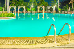 Night scene of the green swimming pool with reflecting water Royalty Free Stock Images