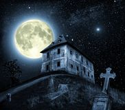 Night scene with haunted house. Halloween scene with full moon and haunted house Stock Images