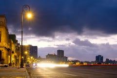Night scene in Havana at the Malecon seaside avenue. Night scene in Havana on the famous Malecon seaside avenue Royalty Free Stock Photos