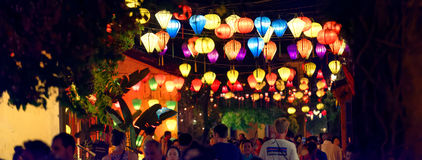 Night scene in Hoi An town. With people walking under colorful lanterns, Vietnam royalty free stock image