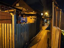 Night scene of homes along Chew Jetty, Penang royalty free stock images