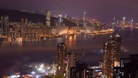 Hong Kong Island and kowloon night scene. Night scene of Hong Kong Island and kowloon, taken from Devil`s Peak Stock Photos