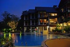 Night scene of hotel and swimming pool Stock Image