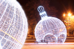 Night scene with illuminated Christmas balls. Beautiful night scene with illuminated Christmas balls in the early morning fog stock photography