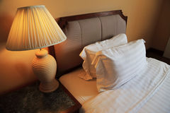 Night scene image of comfortable pillows and bed Royalty Free Stock Image
