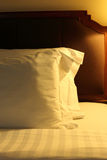 Night scene image of comfortable pillows and bed. Stock Photography
