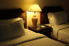 Night scene image of comfortable pillows and bed. Stock Photo