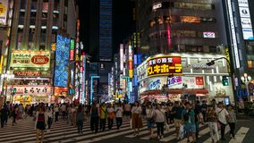 Night scene from Kabukicho district in Shinjuku with bright lights and people walking, Tokyo, Japan. Tokyo, Japan - August 2018: Night scene from Kabukicho royalty free stock photography
